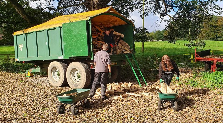 The Saturday club emptying wood from a trailer