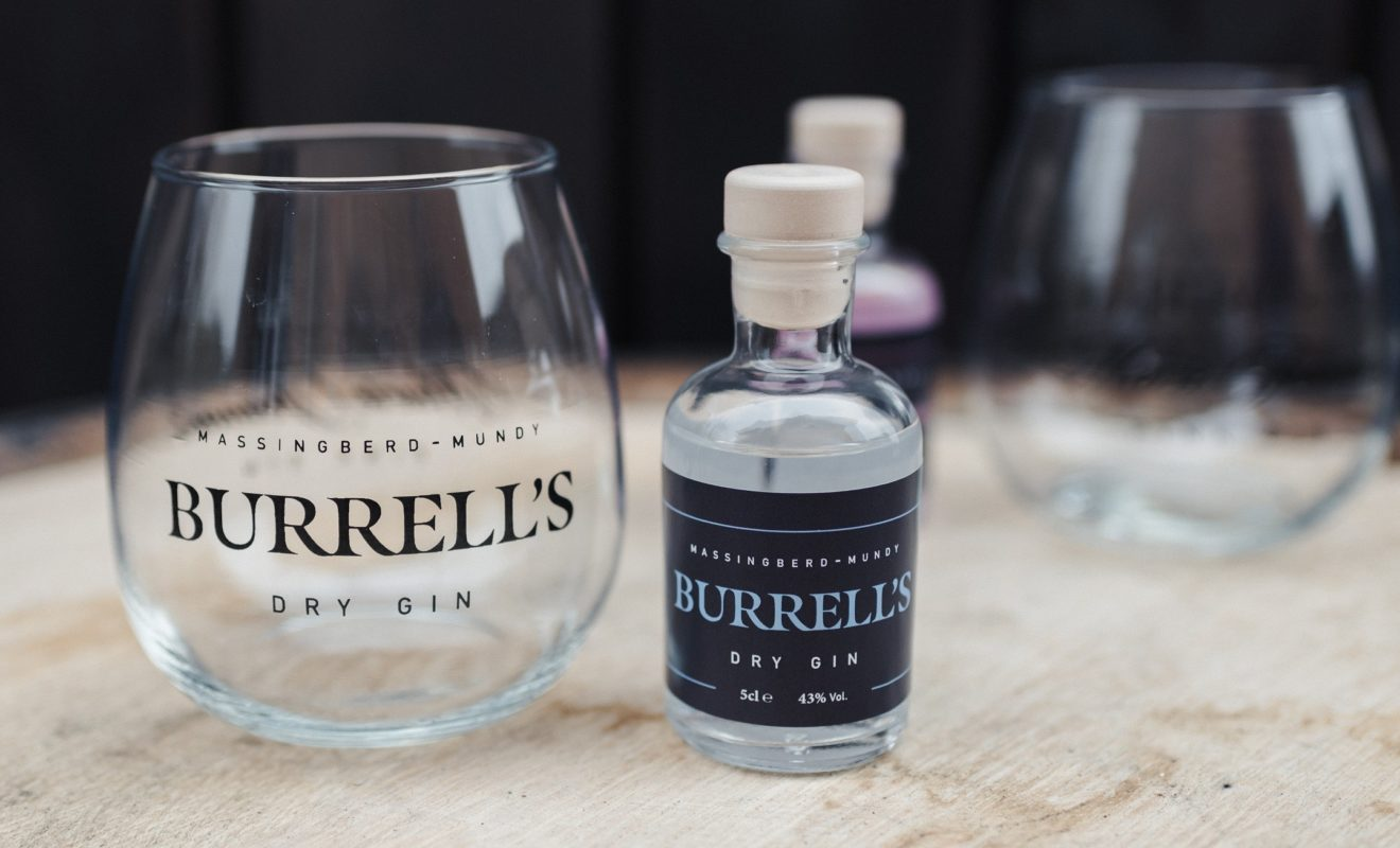 Burrell's London Dry Gin alongside a stemless balloon glass