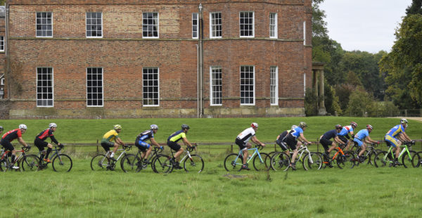 A group of cyclists riding in the fields outside south ormsby estate hall