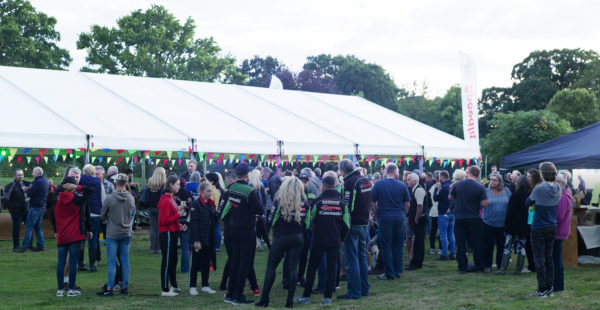 Large group of people stood outside a marquee on South Ormsby Estate grounds.