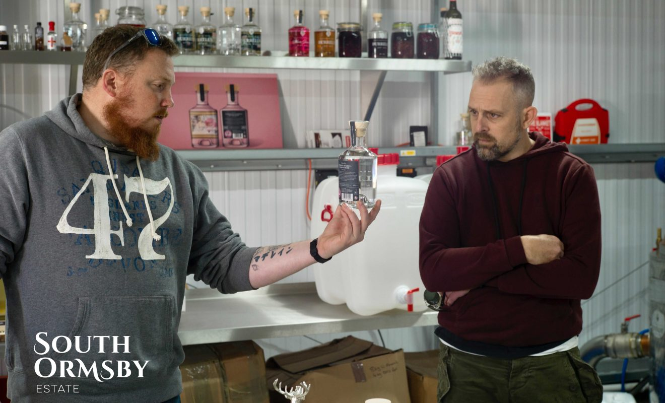 Tristan discussing Distillery Gin with the Bluebell Inn owner
