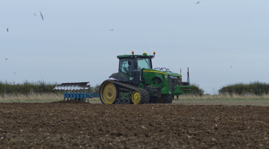 Tractor making its way through a Lincolnshire Field