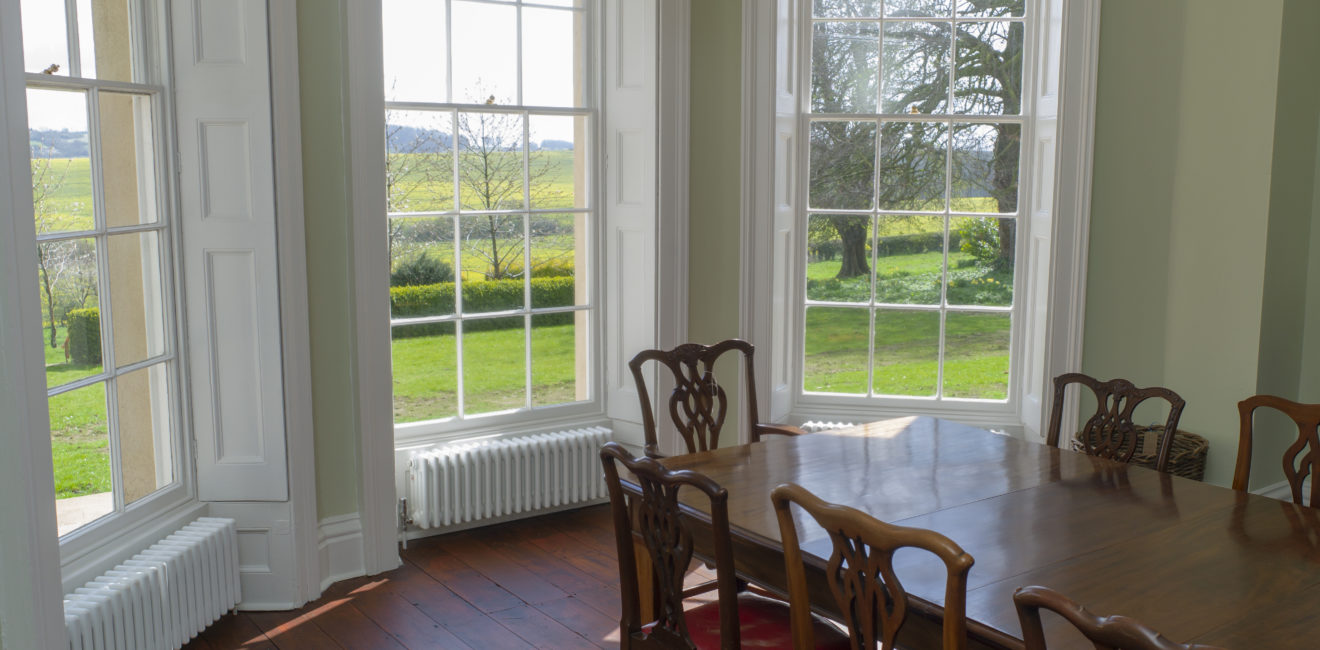 Dining Room view from South Ormsby Hall looking out onto parklands through three bay windows.